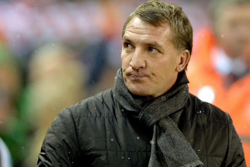 Liverpool will be back challenging for the Premier League title next season after slipping off the pace this time round, manager Brendan Rodgers (above) said on Thursday. -- PHOTO: EPA