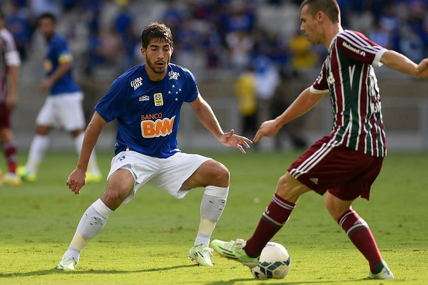 Cruzeiro have agreed to sell defensive midfielder Lucas Silva (above left) to Real Madrid, the Brazilian champions said on Thursday. Spanish media reported the fee would be around €15 million (S$23 million). -- PHOTO: AFP