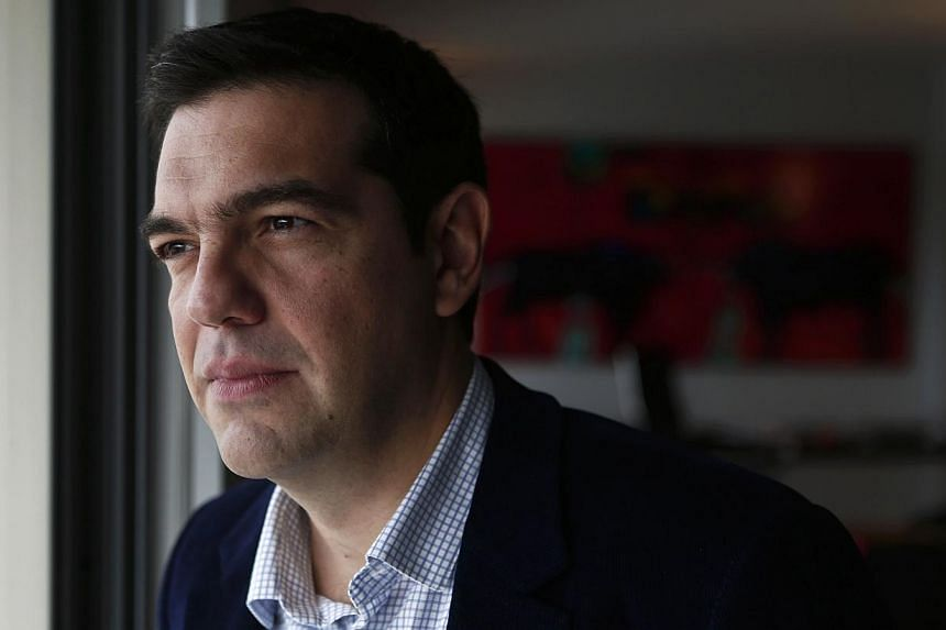 """Greek leftist leader Alexis Tsipras on Friday said an absolute majority in Sunday's general election would """"free"""" his hands to renegotiate the country's massive debt. -- PHOTO: REUTERS"""