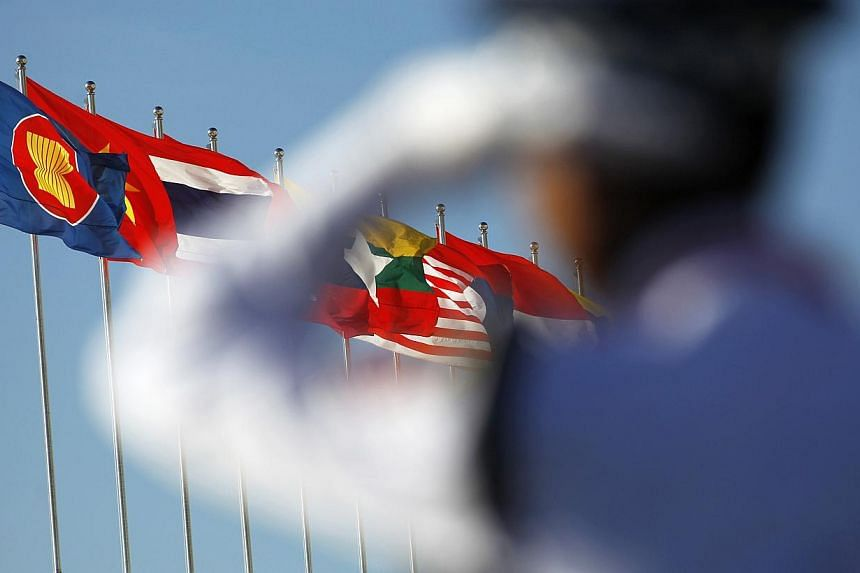 """Asean will officially call itself a single market by year's end, but """"big things"""" like seamless travel within the 10-nation bloc would only come in 2020, Malaysia's trade minister told AFP in an interview. -- PHOTO: REUTERS"""