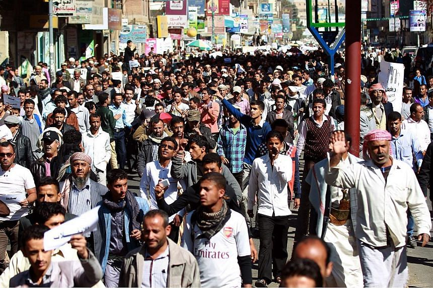 Yemenis take part in a rally against the control of capital the by Shiite Huthi rebels on Jan 24, 2015, in the capital Sanaa. -- PHOTO: AFP