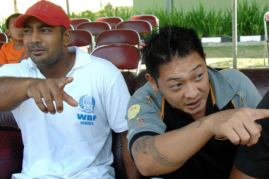 In this file photo taken on Aug 17, 2010, convicted Australian drug smugglers Myuran Sukumaran (left) and Andrew Chan (right) sit inside Kerobokan prison in Denpasar, Bali.The families of two Australian drug convicts facing execution in Indones