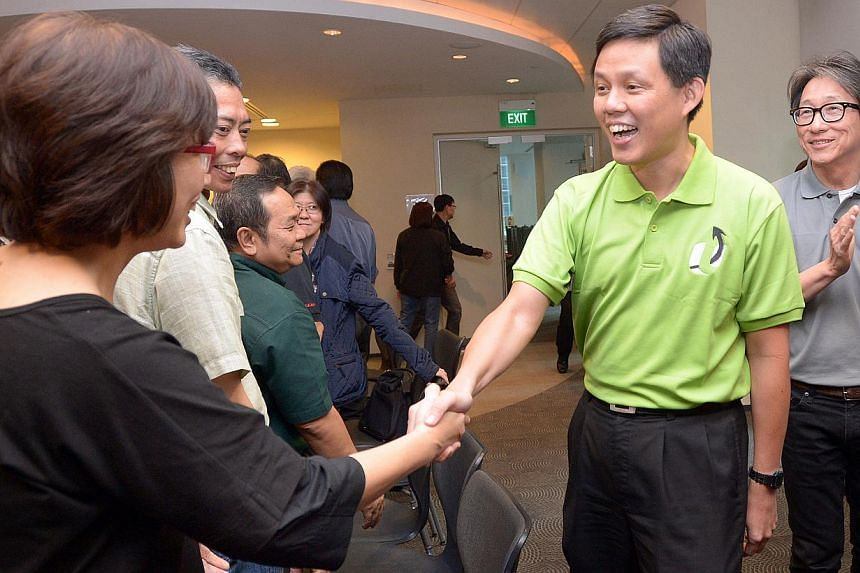 Mr Chan Chun Sing (centre), accompanied by Current NTUC secretary-general Lim Swee Say (right), greeting union leaders at NTUC Centre on Jan 23, 2015. -- ST PHOTO: LIM SIN THAI