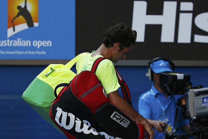Switzerland's Roger Federer walking off the court after being defeated by Andreas Seppi of Italy in their men's singles third round match at the Australian Open 2015 tennis tournament in Melbourne on Jan 23, 2015. -- PHOTO: REUTERS