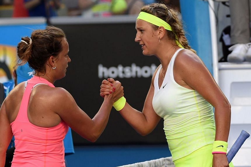 Victoria Azarenka (right) of Belarus greets Barbora Zalhavova Strycova of Czech Republic after winning their women's singles match on day six of the 2015 Australian Open tennis tournament in Melbourne on Jan 24, 2015.  -- PHOTO: AFP