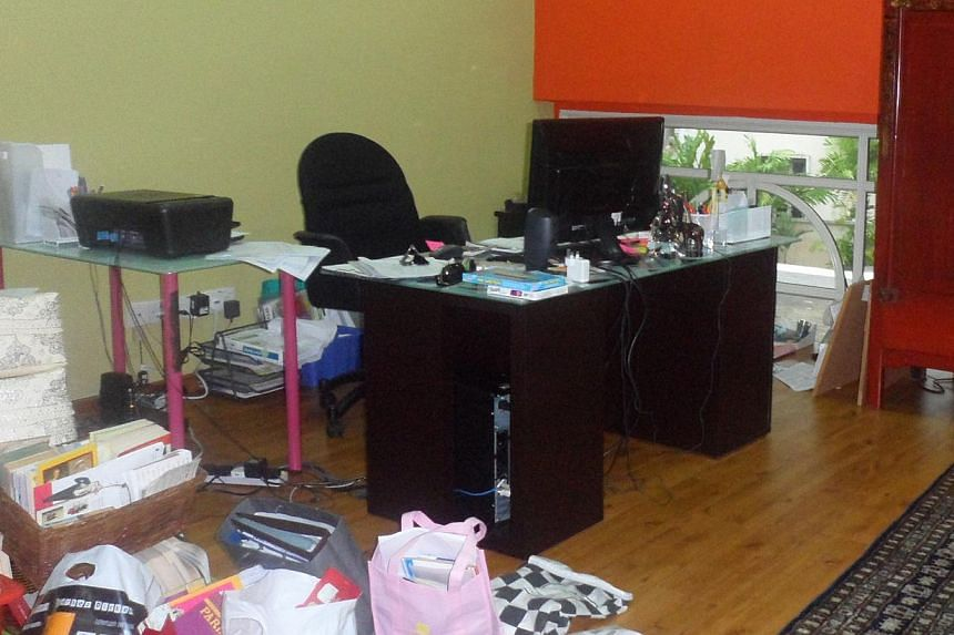 Your office desk should hold only essentials such as a computer, a telephone and paperwork that requires immediate attention (left). Shelves along walls (right) provide storage that helps to reduce the clutter (above) in this study. Keep personal kni