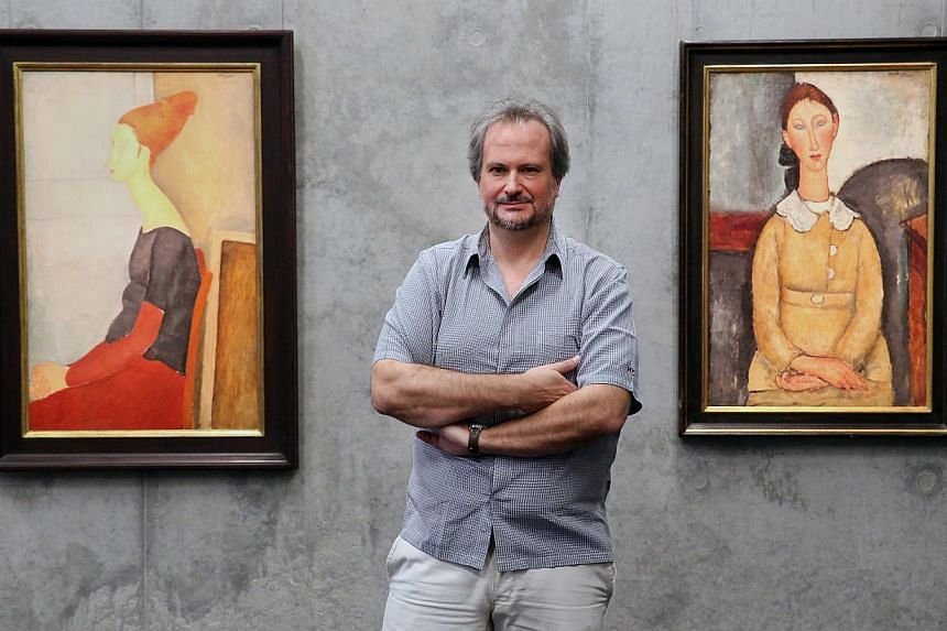Mr Marc Restellini intends to share rarely seen 20th-century artworks, such as the paintings of Italian artist Amedeo Modigliani (above), at Singapore Pinacotheque De Paris (artist impression) at Fort Canning Arts Centre. -- ST PHOTO: NEO XIAOBIN