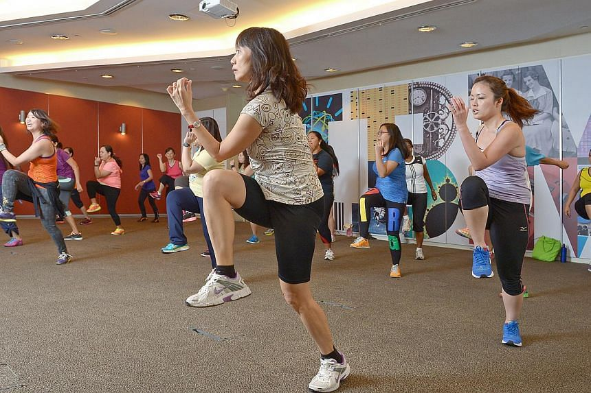 Staff of IBM at their weekly zumba class in the company auditorium. The tech corporation has also given about 2,000 staff worldwide a Fitbit, a wrist-worn fitness tracker, as part of a pilot programme. If the pilot works, IBM plans to give the device