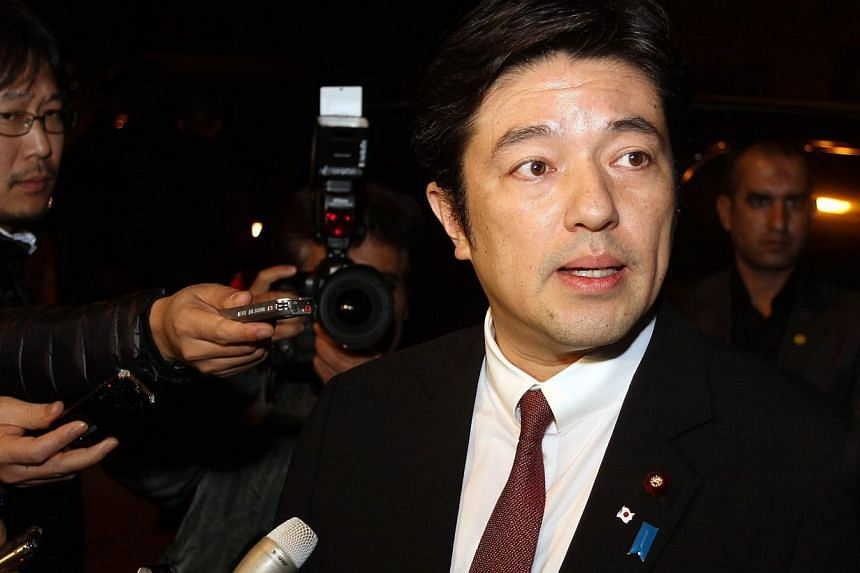 Japanese Vice-Foreign Minister Yasuhide Nakayama speaking to reporters at a hotel in Amman, Jordan on Jan 23,  2015. Mr Nakayama is heading the negotiations for the release of the two hostages. -- PHOTO: EPA