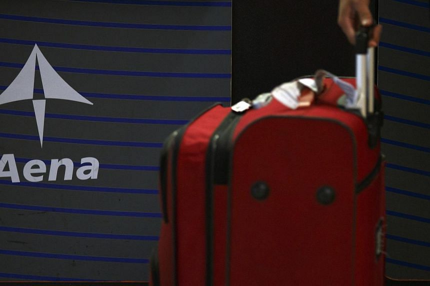 The Spanish government said Friday it would float a section of the world's largest airport operator Aena as part of a much-delayed privatisation of the firm, Europe's first major stock market listing of the year. -- PHOTO: REUTERS