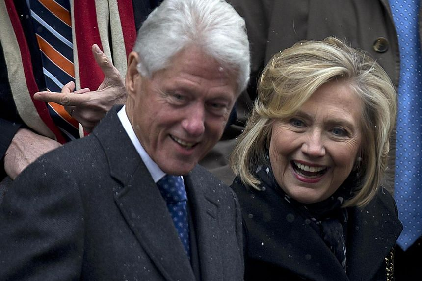 Former US president Bill Clinton and former US secretary of state Hillary Clinton depart the former governor of New York Mario Cuomo's funeral in Manhattan, New York Jan 6, 2015. Famed director Marin Scorsese has shelved a partly finished docume