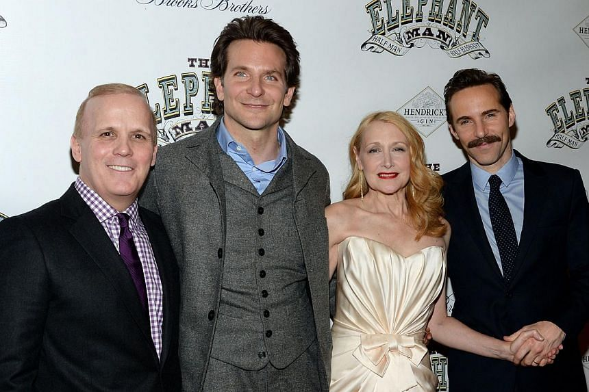 Director Scott Ellis (far left) with actors Bradley Cooper, Patricia Clarkson and Alessandro Nivola at a party following the opening night of The Elephant Man on Broadway. -- PHOTO: AFP