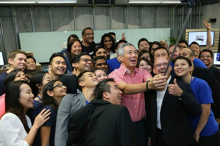 Mr Lee with staff of Facebook in Singapore. -- PHOTO: MCI/LEE HSIEN LOONG/FACEBOOK