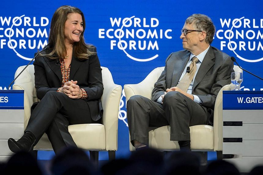 Melinda (left) and Bill Gates attend a session at the Congress Center during the World Economic Forum (WEF) annual meeting on Jan 23, 2015, in Davos. -- PHOTO: AFP