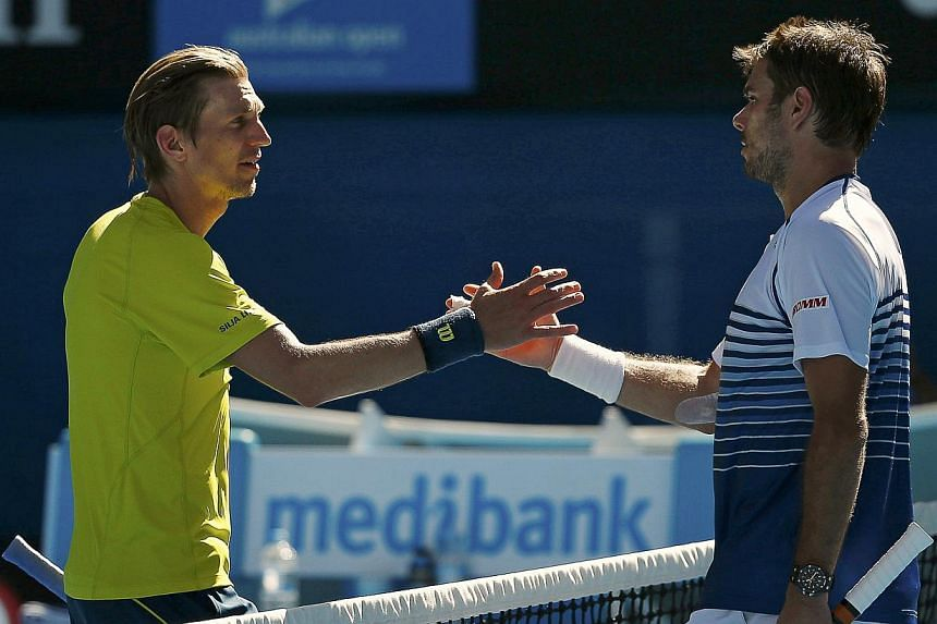 Stan Wawrinka (right) of Switzerland shakes hands with Jarkko Nieminen of Finland after winning their men's singles third round match at the Australian Open 2015 tennis tournament in Melbourne on Jan 24, 2015. -- PHOTO: REUTERS