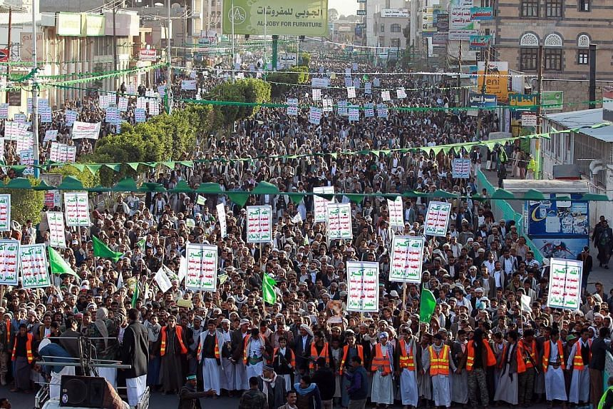 Followers of the Houthi movement march during a demonstrate to show support for the Shiite movement's uprising, which resulted them taking control of Sanaa, in the Yemeni capital on Jan 23, 2015. Yemen faced a dangerous power vacuum after its preside