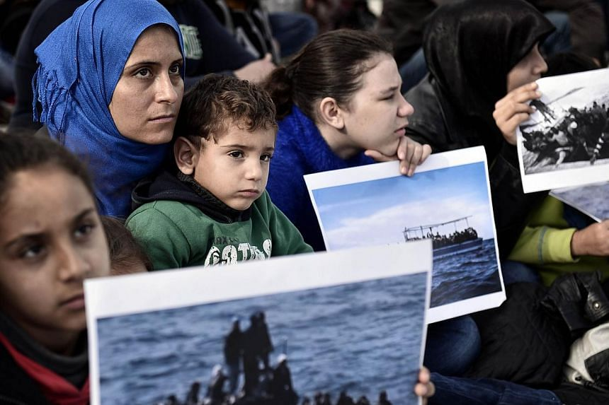 Syrian refugees living in Greece protest on Nov 19, 2014 in Athens, calling for immediate asylum status and housing.More than half of Europeans want less migration with up to 84 per cent of Greeks against any further rise, the International Org