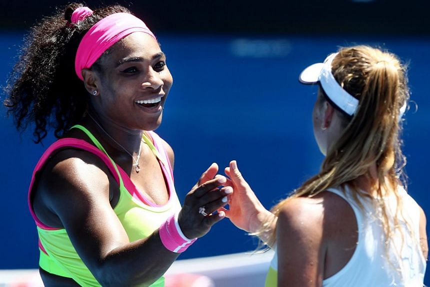 Serena Williams of the USA (left) touches hands with Elina Svitolina of the Ukraine (right) after winning in their third round match of the Australian Open tennis tournament at Melbourne Park in Melbourne, Australia, Jan 24, 2015. -- PHOTO: EPA