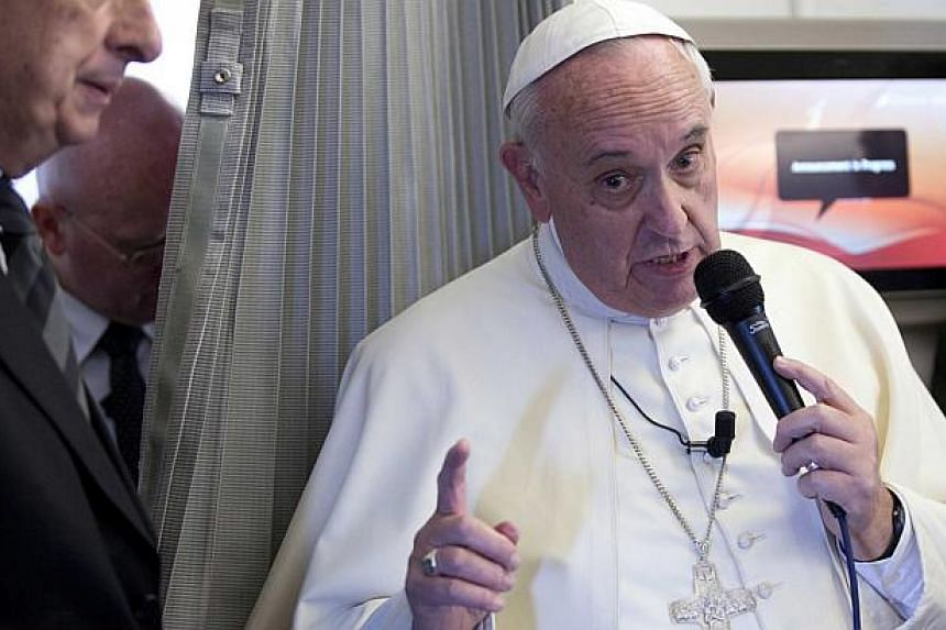 Pope Francis (above right) has told the men he will elevate to the high rank of cardinal next month to be humble and shun lavish parties in their honour, saying they can do more damage than alcohol on an empty stomach. -- PHOTO: EPA