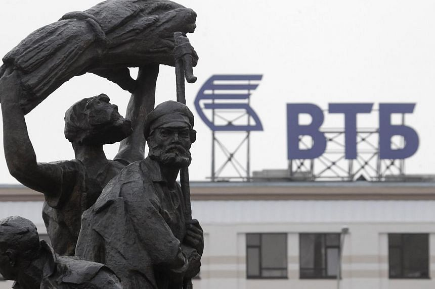 A fragment of a monument to Soviet state founder Vladimir Lenin is on display, with the advertising logo of VTB Bank seen in the background, in Stavropol, southern Russia, Jan 22, 2015.Russia may have to spend more than US$40 billion (S$53 bill