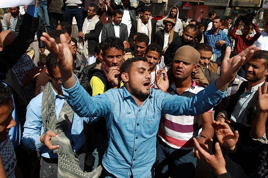 Yemeni protesters shout slogans during a rally against the control of the capital by Shi'ite Houthi rebels on Jan 23, 2015 in the capital Sanaa. -- PHOTO: AFP