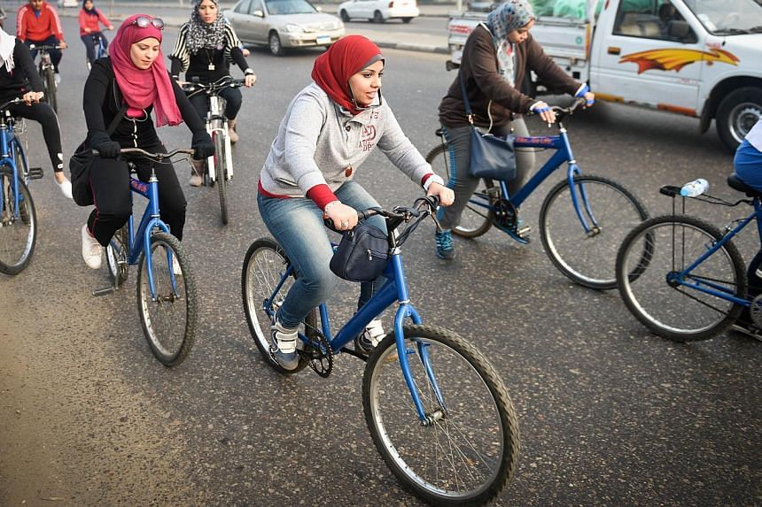 Egyptian members of the Go Bike group taking part in a bicycle ride in Cairo on Dec 27, 2014. -- PHOTO: AFP