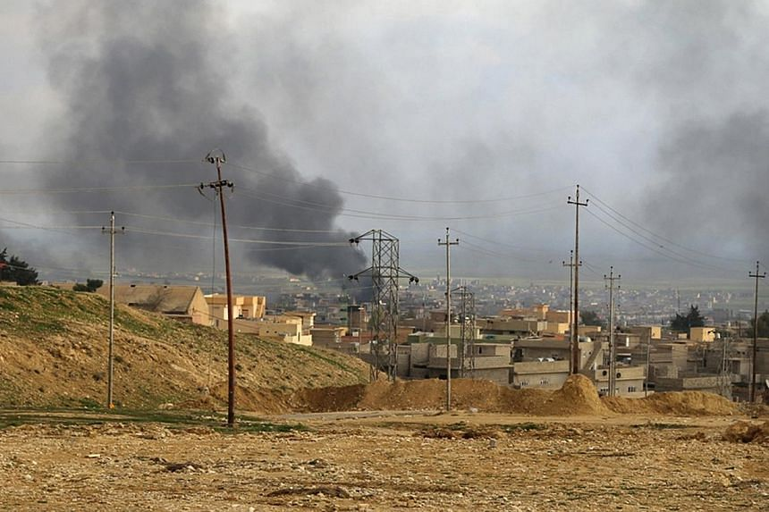 A general view shows the town of Sinjar as smoke rises from what activists said were US-led air strikes on Dec 22, 2014. Syrian President Bashar al-Assad has said US-led air strikes against Islamic State in Iraq and Syria (ISIS) militants in Syria sh