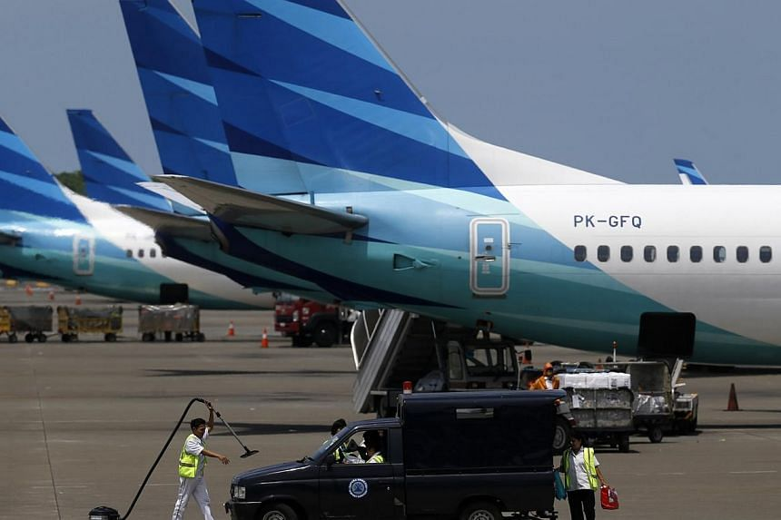 A Garuda Indonesia flight departing from Manokwari in West Papua to Jayapura in the eastern tip of Papua province was forced to make an emergency landing after its wing was damaged, likely by a lightning strike. -- PHOTO: REUTERS