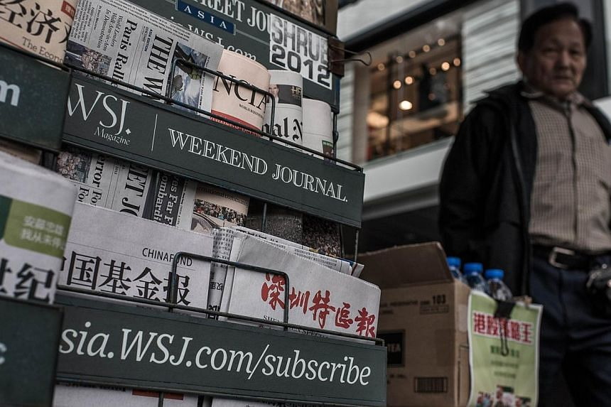 """A report by the International Federation of Journalists warned on Monday, Jan 26, 2015, of """"intervention behind the scenes"""" of Hong Kong's media as fears grow over press freedoms and interference from Beijing. -- PHOTO: AFP"""