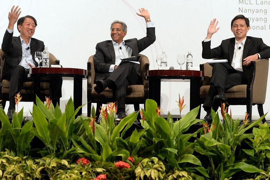 (From left) DPM Teo Chee Hean, Institute of Policy Studies directorJanadas Devan and new labour chief Chan Chun Sing speaking at the dialogue session at the annual Institute of Policy Studies Perspectives Conference on Jan 26, 2015. -- ST PHOTO