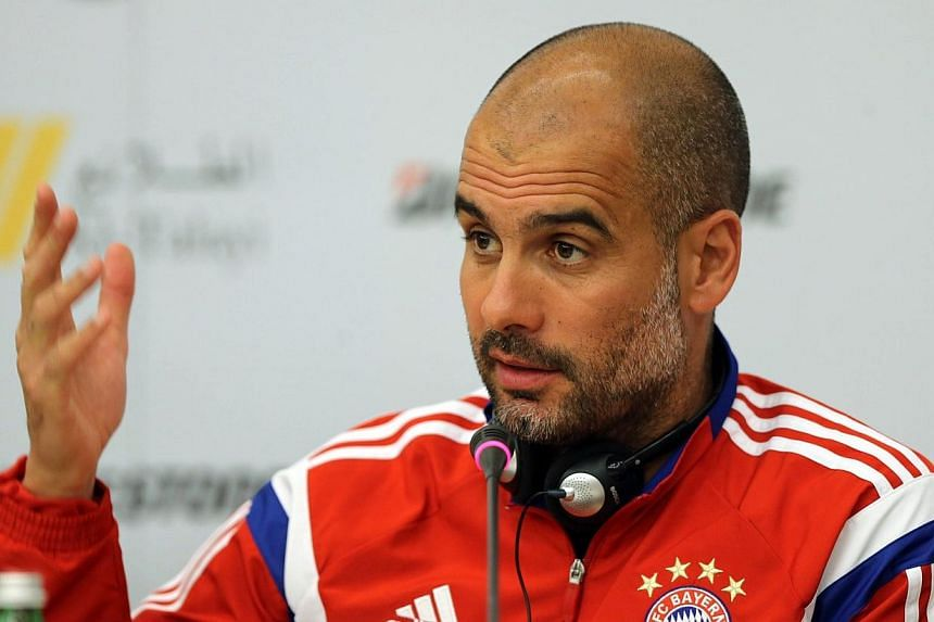 "Bayern Munich's Spanish Manager Josep ""Pep"" Guardiola speaks during a press conference in Riyadh on Jan 17, 2015, ahead of their friendly match with Saudi Al-Hilal. The German champions have repeatedly signalled their desire for a contract extension"