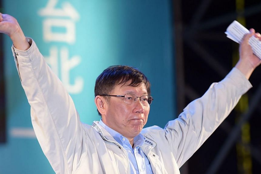 Newly-elected independent Taipei Mayor Ko Wen-je gestures after winning the mayor elections in Taipei on Nov 29, 2014. Mr Ko and British transport minister Baroness Susan Kramer committed a double gaffe on Monday, Jan 26, 2015, after she present
