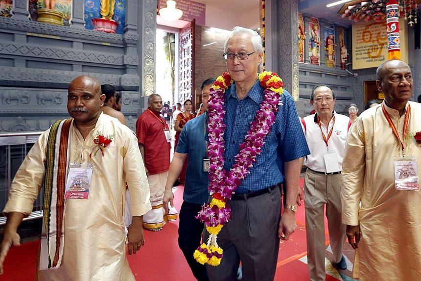 ESM Goh Chok Tong attending the consecration ceremony for the 120-year-oldSri Senpaga Vinayagar Temple in Katong on Jan 26, 2015.-- ST PHOTO: CHEW SENG KIM