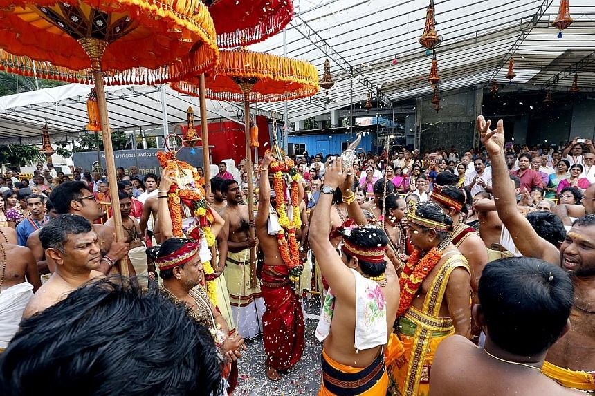 Thousands of devotees and well-wishers thronged the 120-year-old Sri Senpaga Vinayagar Temple in Katong for its consecration ceremony on Jan 26, 2015.-- ST PHOTO: CHEW SENG KIM