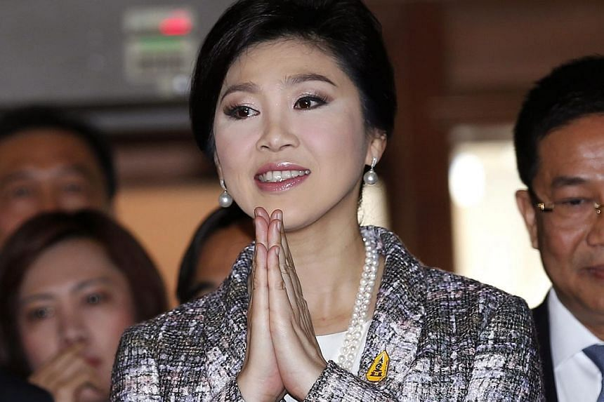 Former Thai prime minister Yingluck Shinawatra gives a greeting as she arrives to answer questions to the National Legislative Assembly (NLA) during impeachment proceedings against her, at Parliament House in Bangkok, Thailand, on Jan 22, 2015.