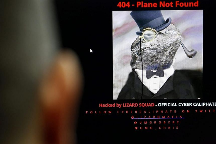 A computer user looks at a screen displaying the official Malaysia Airlines website as it has been hacked, in Bangkok, Thailand on Jan 26, 2015.-- PHOTO: EPA
