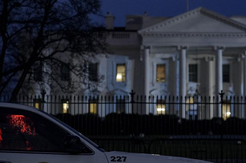 A member of the Secret Service's Uniformed Division sits in his car on Pennsylvania Avenue outside the White House on Jan 26, 2015, in Washington, DC.The Secret Service recovered a small, remote-controlled drone on the White House grounds
