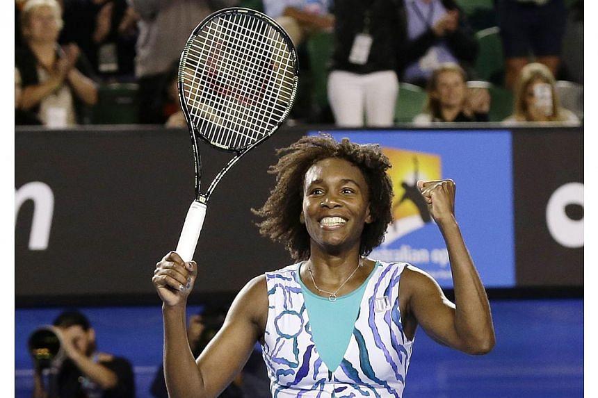 Venus Williams of the US jubilates after winning against Agnieszka Radwanska of Poland in their fourth round match at the Australian Open Grand Slam tennis tournament in Melbourne, Australia on Jan 26, 2015. -- PHOTO: EPA