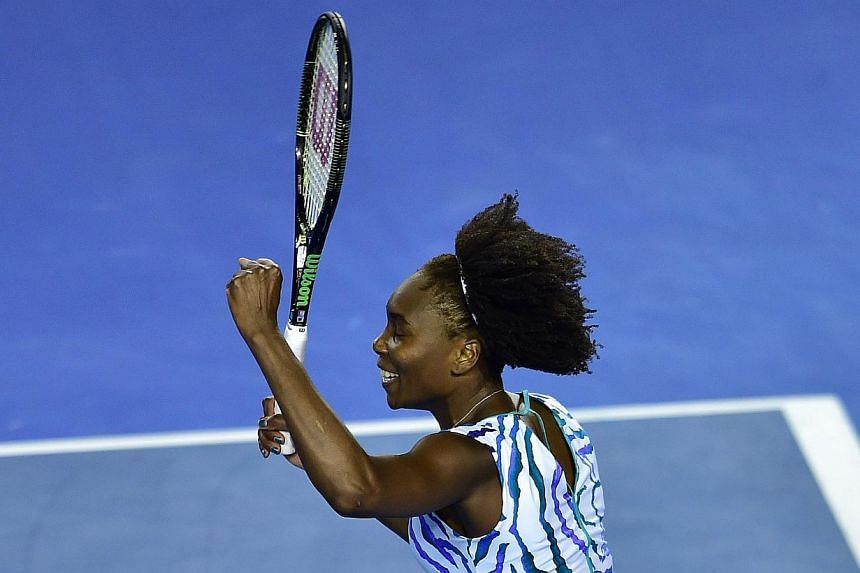 Venus Williams of USA (left) is congratulated on her win against Agnieszka Radwanska of Poland on Australia Day during the Australian Open at Melbourne Park, Melbourne, Australia on Jan 26, 2015. Seven-time Grand Slam champion Venus Williams sto