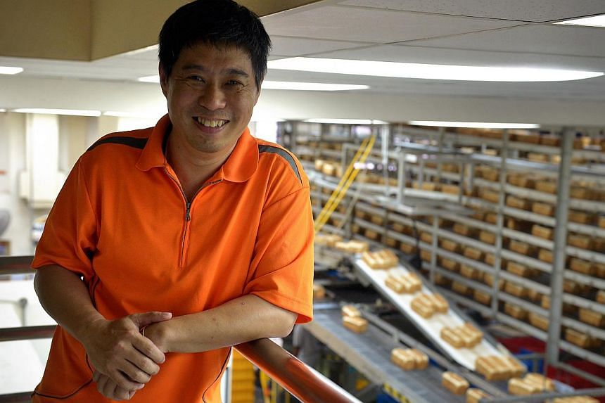 Besides the main line (left) which produces 10,000 loaves of bread a day, Mr Leong (above) set up an artisan section, where inmates make tasty treats such as pineapple ingots and macarons, which are then supplied to cafes and confectionaries.