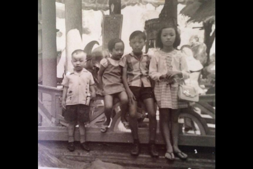 Ms Clara Cheo (above, second from left) in the 1970s with her siblings and with her husband Eddie Ling and sons Travis and Aidan in 2005 (right). Ms Cheo (above, front row, seventh from left) at a Golden Village strategic workshop in 2013.