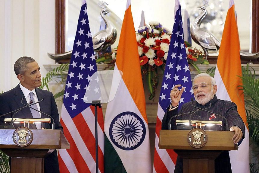 India prime minster Narendra Modi (right) watched by US President Barack Obama during a joint press conferencen at Hyderabad House in New Delhi, India on Jan 25, 2015. -- PHOTO: EPA