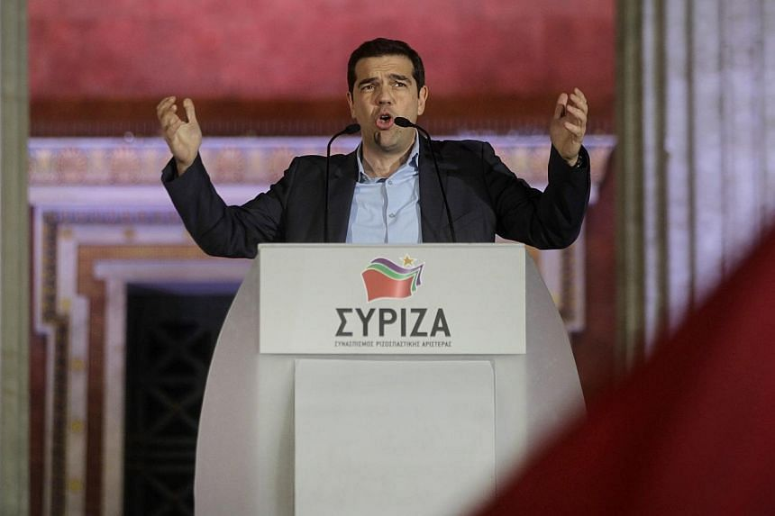 Greek leftist leader Alexis Tsipras will probably be sworn in as prime minister by Monday and have a government in place by Wednesday at the latest, according to a party official. -- PHOTO: EPA