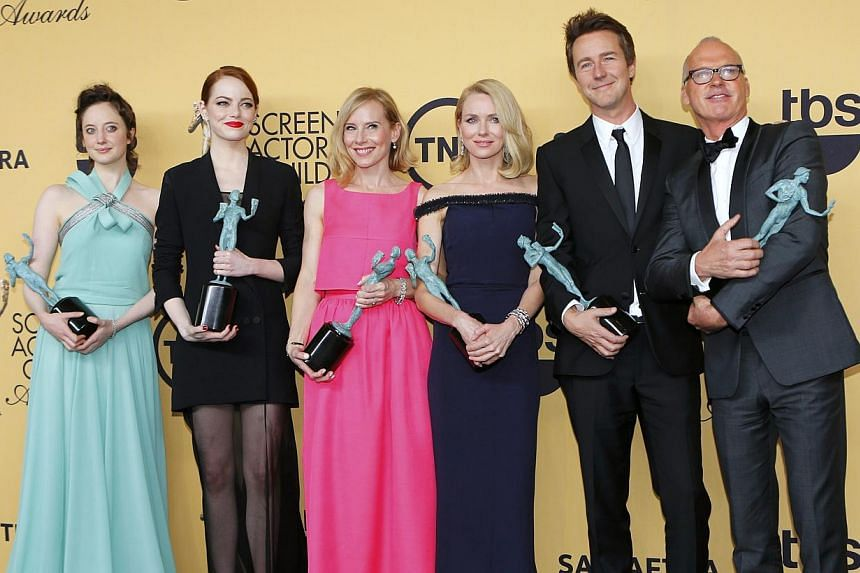 """The cast of """"Birdman"""" (from left) Andrea Riseborough, Emma Stone, Amy Ryan, Naomi Watts, Edward Norton and Michael Keaton pose backstage with their award for Outstanding Performance by a Cast in a Motion Picture at the 21st annual Screen Actors Guild"""