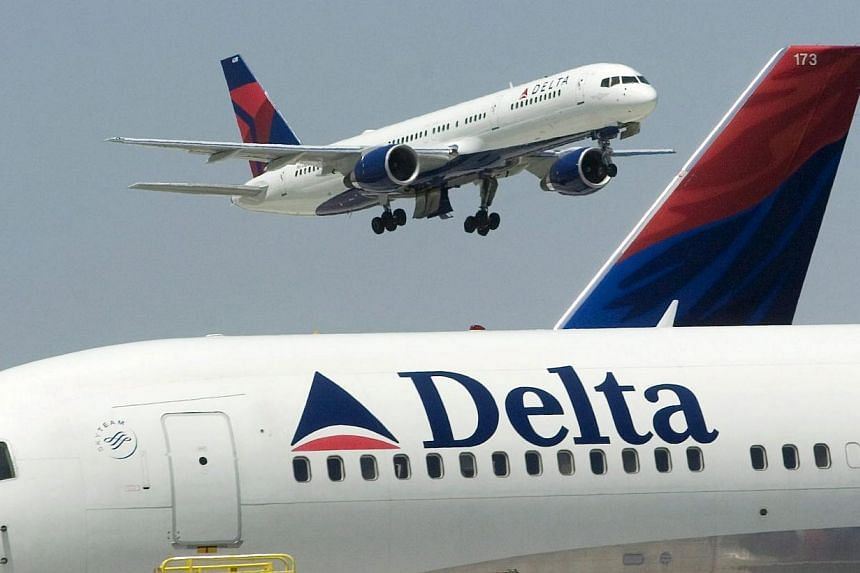 Delta has cancelled about six regional flights into New York for Sunday, the spokesman added. -- PHOTO: EPA