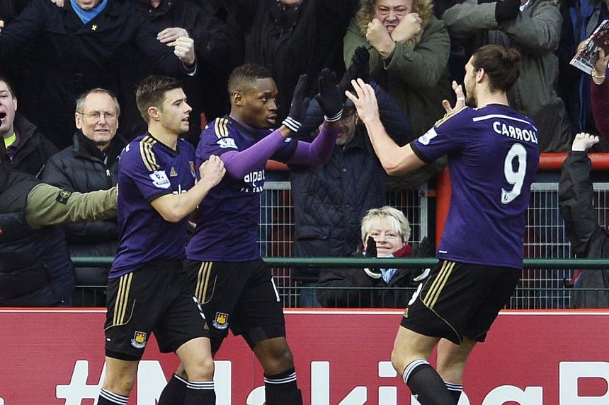 West Ham United's Diafra Sakho (centre) celebrates with team mates Aaron Cresswell (left) and Andy Carroll after scoring a goal against Bristol City during their FA Cup fourth round soccer match at the Ashton Gate Stadium in Bristol, southern England