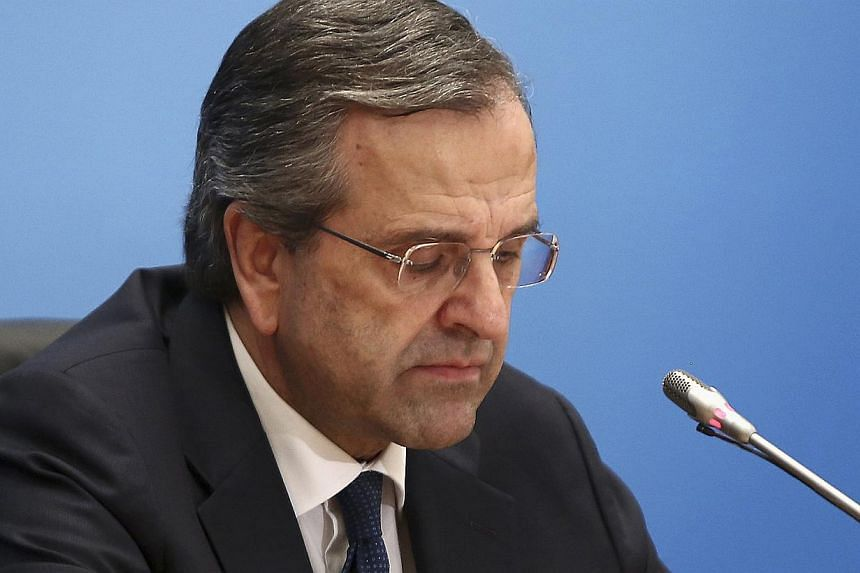 Outgoing Greek Prime Minister Antonis Samaras reacts before a news conference following an updated exit poll in Athens on Sunday. Samaras said he respected the decision of the Greek electorate after official projections showed voters rejecting his co