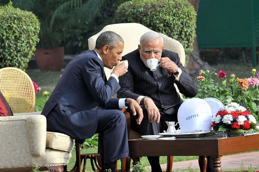 Indian Prime Minister Narendra Modi (right) in 'One on One' talks while having tea with US President Barack Obama (left) in the gardens of Hyderabad House, in New Delhi on Sunday as seen in a handout image provided by the Press Information Bureau of