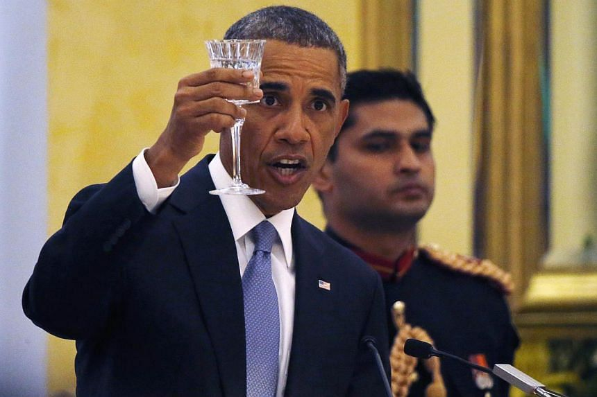 United States President Barack Obama delivers a toast as he attends an official state dinner with India's President Pranab Mukherjee and Prime Minister Narendra Modi at the Rashtrapati Bhavan presidential palace in New Delhi on Sunday. -- PHOTO: &nbs