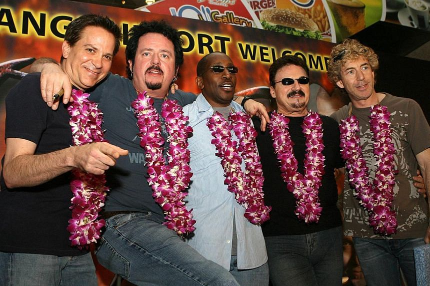 Legendary US rock group TOTO pose for photographs upon arrival at Changi Airport in Singapore in a 2006 file photo. -- PHOTO: AFP